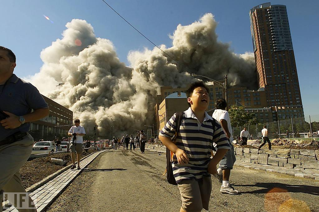 """People race away from the ruin as the World Trade Center's North Tower collapses. (Photo: Jose Jimenez/Primera Hora/Getty Images)<br><br>For the full photo collection, go to <a target=""""_blank"""" href=""""http://www.life.com/gallery/63651/confronting-terror-faces-of-911#index/0"""">LIFE.com</a>"""