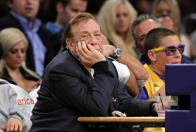 FILE - In this Feb. 25, 2011, file photo, Los Angeles Clippers owner Donald Sterling looks on during the first half of their NBA basketball game against the Los Angeles Lakers in Los Angeles. NBA Commissioner Adam Silver has banned Sterling for life and fined him $2.5 million for making racist comments. (AP Photo/Mark J. Terrill, File)
