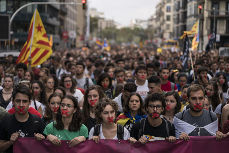 Independence supporters march during a demonstration in Barcelona, Spain, Monday, Oct. 2, 2017. Catalan leaders accused Spanish police of brutality and repression while the Spanish government praised the security forces for behaving firmly and proportionately. Videos and photographs of the police actions were on the front page of news media outlets around the world. (AP Photo/Felipe Dana)