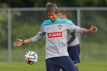Portugal's national soccer team player Fabio Coentrao warms up for a training session, ahead of their international friendly soccer match against Mexico June 6 in preparation for the 2014 World Cup in Brazil, in Foxborough, Massachusetts June 5, 2014. REUTERS/Brian Snyder/Files