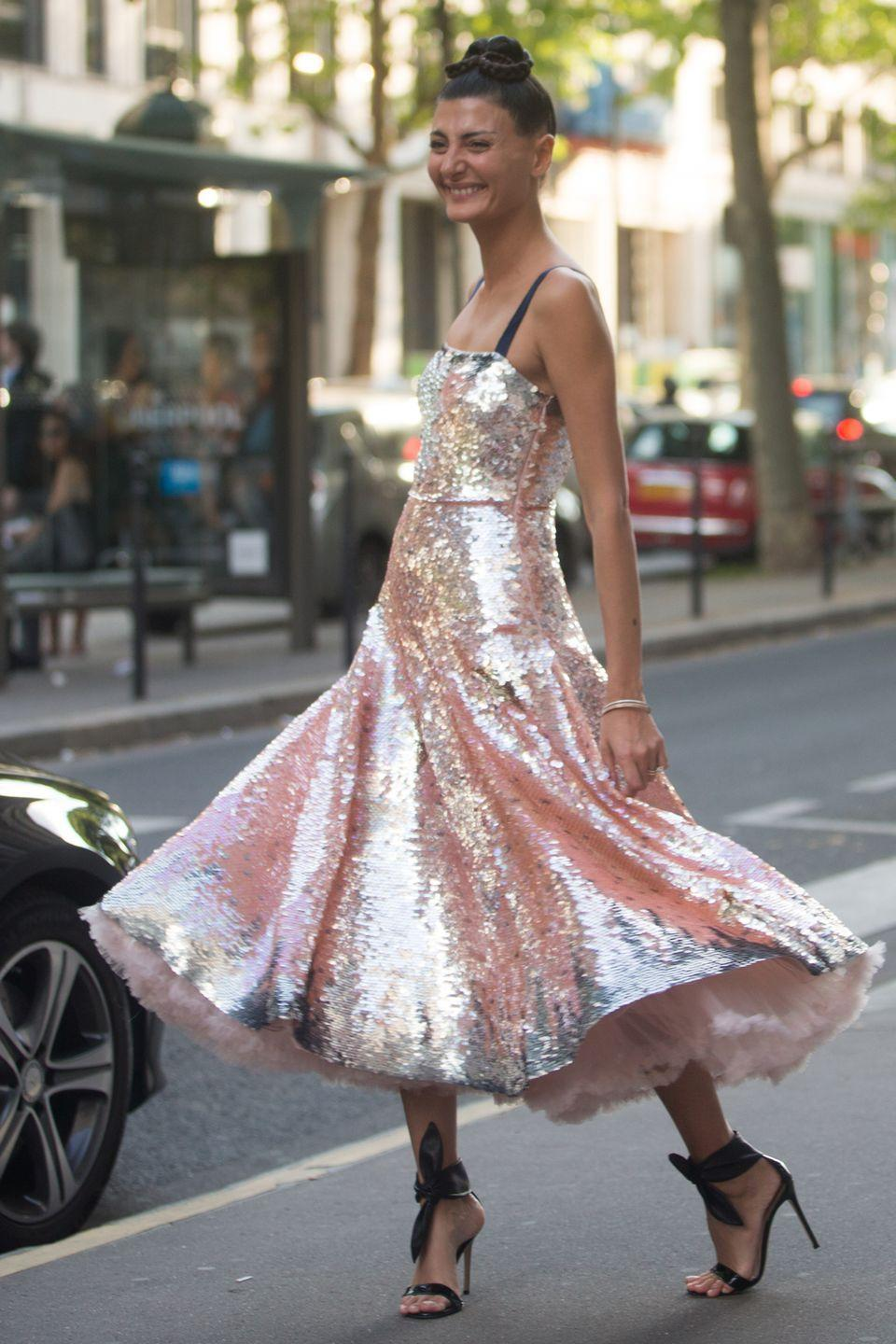 <p>What better place to wear a sequinned Valentino dress than at its Paris catwalk show? Battaglia proves sequins are not just for night; all that's required is pared-back hair and make-up and a dose of confidence.</p>