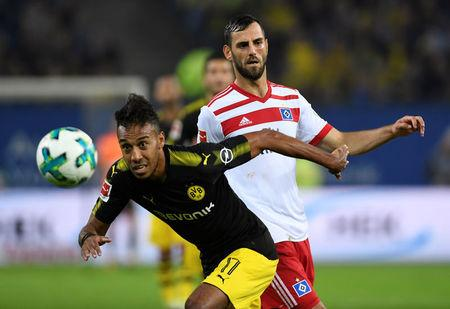 Borussia Dortmund's Pierre-Emerick Aubameyang in action with Hamburg's Mergim Mavraj.     REUTERS/Fabian Bimmer