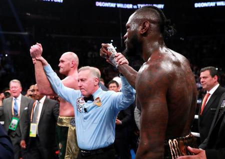 Boxing - Deontay Wilder v Tyson Fury - WBC World Heavyweight Title - Staples Centre, Los Angeles, United States - December 1, 2018 Deontay Wilder and Tyson Fury react after the fight Action Images via Reuters/Andrew Couldridge