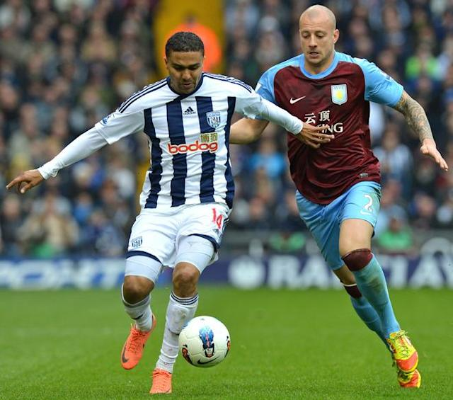 "West Bromwich Albion's English midfielder Jerome Thomas (L) vies with Aston Villa's Scottish defender Alan Hutton (R) during the English Premier League football match between West Bromwich Albion and Aston Villa at The Hawthorns in West Bromwich, central England, on April 28, 2012. AFP PHOTO/BEN STANSALL RESTRICTED TO EDITORIAL USE. No use with unauthorized audio, video, data, fixture lists, club/league logos or ""live"" services. Online in-match use limited to 45 images, no video emulation. No use in betting, games or single club/league/player publications.BEN STANSALL/AFP/GettyImages"