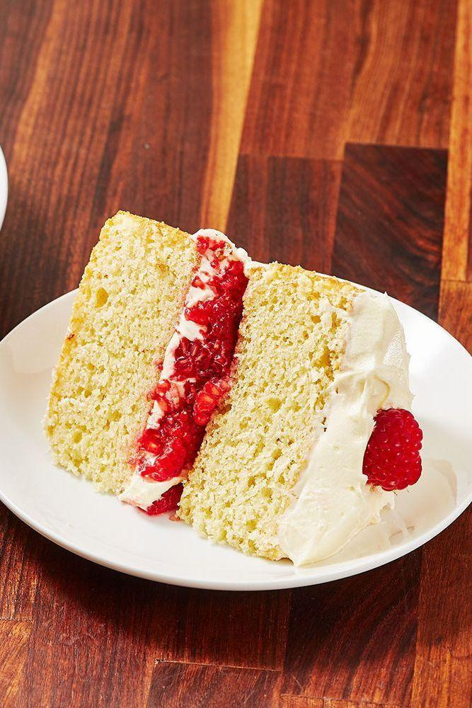 """<p><a href=""""https://www.delish.com/uk/cooking/recipes/a30268579/vegan-banana-bread/"""" rel=""""nofollow noopener"""" target=""""_blank"""" data-ylk=""""slk:Raspberry"""" class=""""link rapid-noclick-resp"""">Raspberry</a> + <a href=""""https://www.delish.com/uk/food-news/a29708464/cadbury-white-chocolate-bar/"""" rel=""""nofollow noopener"""" target=""""_blank"""" data-ylk=""""slk:white chocolate"""" class=""""link rapid-noclick-resp"""">white chocolate</a> = one of our FAVE flavour combos, so this White Chocolate And Raspberry Cake is a natural winner. Made with a basic <a href=""""https://www.delish.com/uk/cooking/recipes/a29286310/victoria-sponge-traybake/"""" rel=""""nofollow noopener"""" target=""""_blank"""" data-ylk=""""slk:vanilla sponge"""" class=""""link rapid-noclick-resp"""">vanilla sponge</a>, the cake is stuffed with raspberries and white chocolate <a href=""""https://www.delish.com/uk/cooking/recipes/a30240654/best-buttercream-frosting-recipe/"""" rel=""""nofollow noopener"""" target=""""_blank"""" data-ylk=""""slk:buttercream"""" class=""""link rapid-noclick-resp"""">buttercream</a>, delicious, delicious, delicious. </p><p>Get the <a href=""""https://www.delish.com/uk/cooking/recipes/a29085895/raspberry-white-chocolate-cake/"""" rel=""""nofollow noopener"""" target=""""_blank"""" data-ylk=""""slk:Raspberry White Chocolate Cake"""" class=""""link rapid-noclick-resp"""">Raspberry White Chocolate Cake</a> recipe.</p>"""