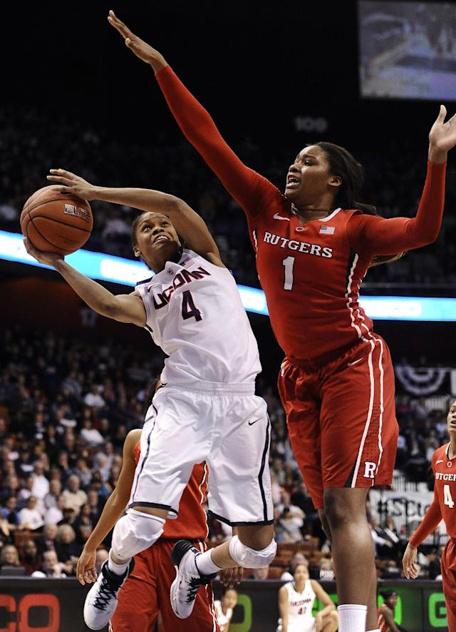 Connecticut's Moriah Jefferson, left, drives to the basket as Rutgers' Rachel Hollivay, right, defends during the second half of an NCAA college basketball game in the semifinals of the American Athletic Conference women's tournament on Sunday, March 9, 2014, in Uncasville, Conn. Connecticut won 83-57. (AP Photo/Jessica Hill)