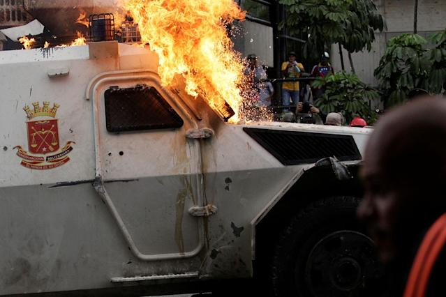 <p>An armored police vehicle is seen on fire during rally against Venezuela's President Nicolas Maduro in Caracas, Venezuela May 3, 2017. (Marco Bello/Reuters) </p>