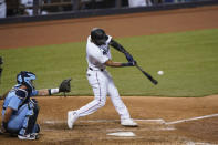 Miami Marlins' Starling Marte hits a home run during the eighth inning of a baseball game against the Toronto Blue Jays, Tuesday, Sept. 1, 2020, in Miami. (AP Photo/Wilfredo Lee)