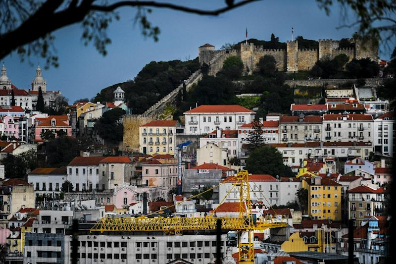 The Portuguese economy relies on tourism but many locals in Lisbon worry their city may not be able to handle the huge influx already pouring in (AFP Photo/PATRICIA DE MELO MOREIRA)