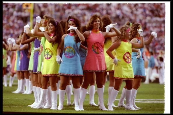 """<div class=""""caption-credit""""> Photo by: Getty Images/Mike Powell</div><div class=""""caption-title""""></div>It may look like your high school production of <i>Sweet Charity,</i> but really it's the big-time: the halftime show at Super Bowl XXV, in 1991, where faux go-go boots and poorly constructed '60s Mod mini-dresses (with tie-dyed…wagon wheels?) are somehow filling out the theme of """"Small World."""" <br>"""