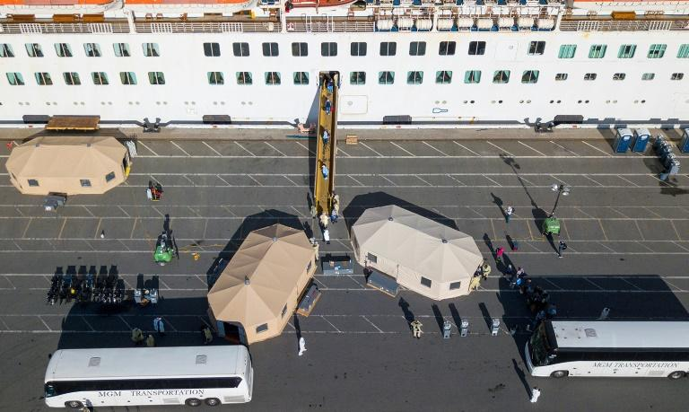 More passengers leave the Grand Princess cruise ship at the Port of Oakland in Oakland, California