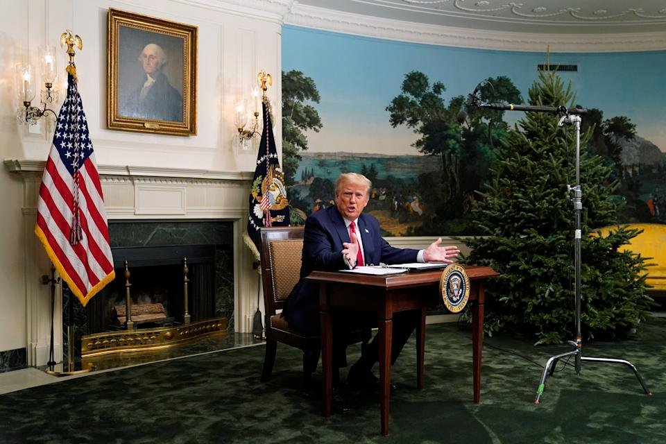 President Donald Trump spoke with reporters following a video chat with members of the military, and the tiny desk he sat at became a meme. (Photo: ASSOCIATED PRESS)