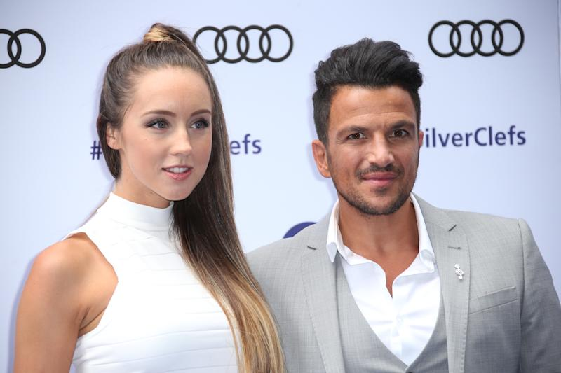 Emily MacDonagh and Peter Andre pose for photographers upon arrival at the Silver Clef Awards in London, Friday, July 1, 2016. (Photo by Joel Ryan/Invision/AP)-