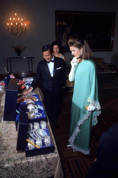 <p>First Lady Jacqueline Kennedy is presented with an assortment of gifts from Cambodian Prince Sihanouk and his wife. </p>
