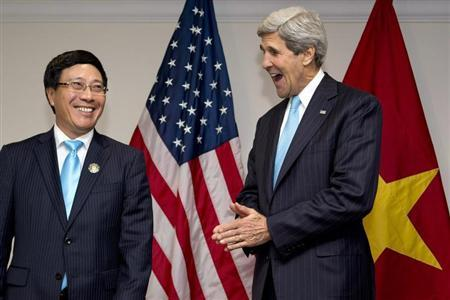 U.S. Secretary of State John Kerry and Vietnam's Foreign Minister Pham Binh Minh smile during an ASEAN meeting in Bandar Seri Begawan