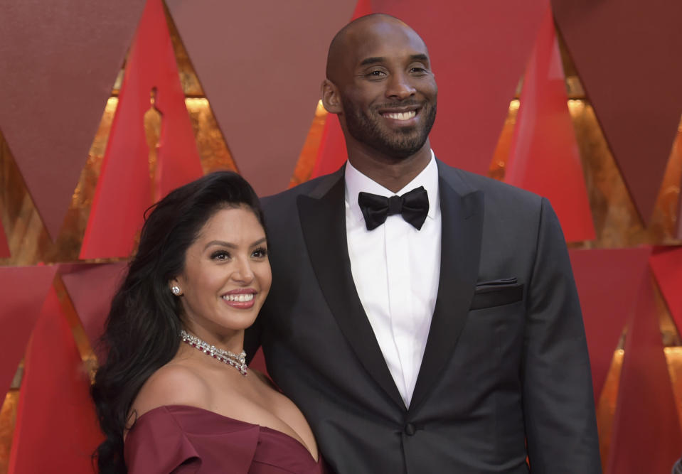 """FILE - In the Sunday, March 4, 2018, file photo, Vanessa Laine Bryant, left, and Kobe Bryant arrive at the Oscars at the Dolby Theatre in Los Angeles. Vanessa Bryant says she is focused on """"finding the light in darkness"""" in an emotional story in People magazine. She details how she attempts to push forward after her husband, Kobe Bryant, and daughter Gigi died in a helicopter crash in early 2020. (Photo by Richard Shotwell/Invision/AP, File)"""