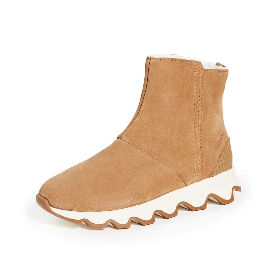 """<p>These <a href=""""https://www.travelandleisure.com/style/shoes/best-snow-boots"""">snow boots</a> have sneaker in their DNA, and the look is really working for us. A wavy rubber sole lends a streetwear energy, and a tan upper makes us feel all warm and hygge inside. Beyond pure aesthetics though, these boots check off all of our key performance boxes: excellent grip, ample insulation, and a side zip for easily sliding on and off.</p> <p><strong>Shop now: </strong>$140; <a href=""""https://click.linksynergy.com/deeplink?id=93xLBvPhAeE&mid=42352&murl=https%3A%2F%2Fwww.shopbop.com%2Fkinetic-short-booties-sorel%2Fvp%2Fv%3D1%2F1578050419.htm&u1=IS%2CWinterboots-Embed%2Clreilly805%2C%2CIMA%2C3481517%2C201909%2CI"""" target=""""_blank"""">shopbop.com</a></p>"""