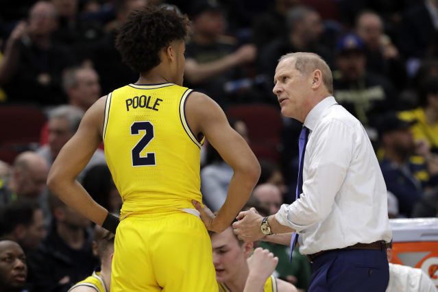 Michigan head coach John Beilein, right, talks to Jordan Poole during the first half of an NCAA college basketball game against Iowa in the quarterfinals of the Big Ten Conference tournament, Friday, March 15, 2019, in Chicago. (AP Photo/Nam Y. Huh)