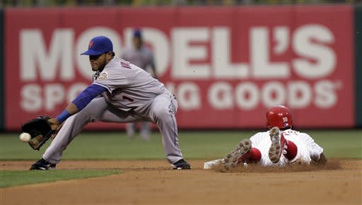 Philadelphia Phillies' Juan Pierre beats the throw to New York Mets Jordany Valdespin, in the first inning of a baseball game, Tuesday, May 8, 2012, in Philadelphia. (AP Photo/Tom Mihalek)
