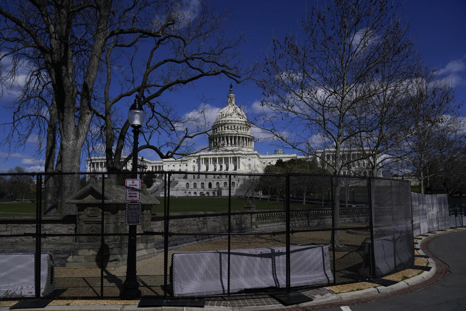 The U.S. Capitol is seen behind security fencing after a car that crashed into a barrier on Capitol Hill in Washington, Friday, April 2, 2021. (AP Photo/Carolyn Kaster)