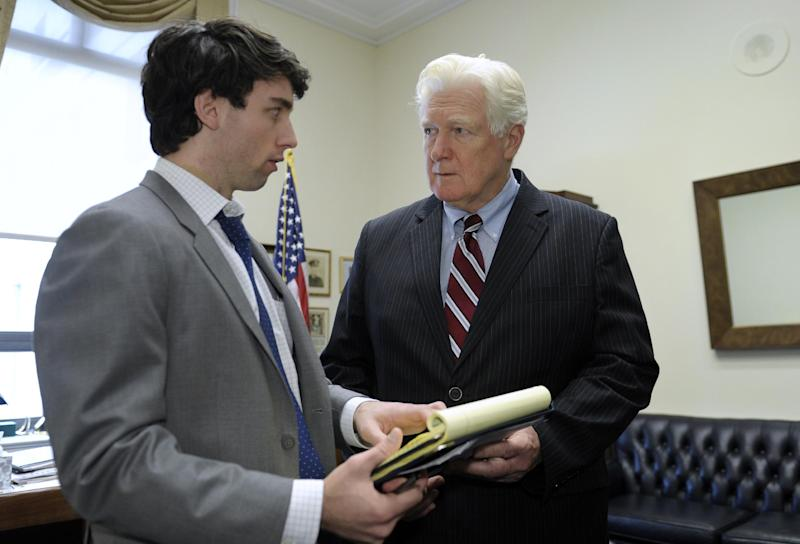 Rep. James Moran, D-Va., right, goes over his schedule with press secretary Thomas Scanlon in his office on Capitol Hill in Washington, Wednesday, Jan. 15, 2014. Moran, a Northern Virginia Democrat, ranking member on the House Appropriations Interior Subcommittee and senior member of the Defense Appropriations Subcommittee, announced that he will not seek re-election. (AP Photo/Susan Walsh)