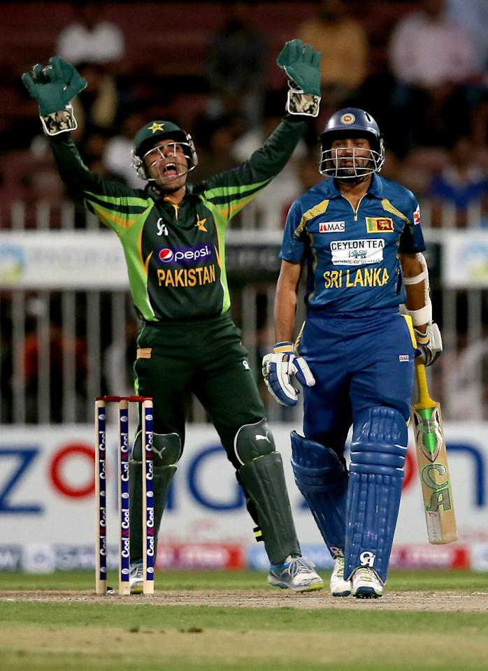 SHARJAH, UNITED ARAB EMIRATES - DECEMBER 18:  Umar Akmal of Pakistan appeal for the wicket of TM Dilshan of Sri lanka during the first One-Day International (ODI ) match between Sri Lanka and Pakistan at the Sharjah Cricket Stadium on December 18, 2013 in Sharjah, United Arab Emirates.  (Photo by Francois Nel/Getty Images)