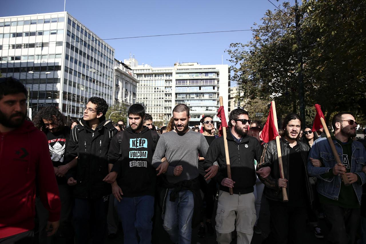 Protesters take part in an anti-austerity rally during a 24-hour strike in Athens, Thursday, Nov. 24, 2016. Greek ferries suspended their routes to and from the country's islands Thursday due to a 24-hour seamen's strike protesting pension cuts and other measures arising from Greece's bailout commitments. (AP Photo/Yorgos Karahalis)