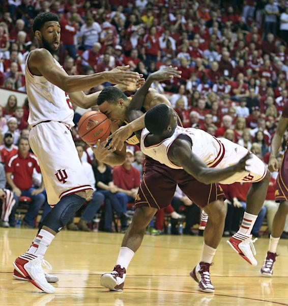 Minnesota's Joe Coleman, cemter, battles Indiana's Christian Watford, left, and Victor Oladipo for a rebound during the first half of an NCAA college basketball game Saturday, Jan. 12, 2013, in Bloomington, Ind. (AP Photo/Darron Cummings)