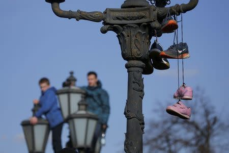 FILE PHOTO: Shoes hung on a lamp post  by opposition supporters are pictured after a rally in Moscow, Russia March 26, 2017. REUTERS/Maxim Shemetov/File Photo