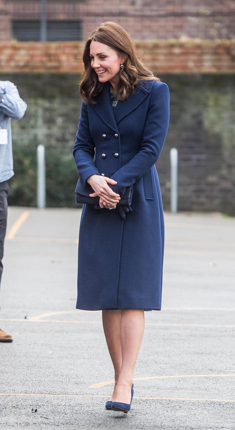 <p><strong>The occassion:</strong> At visit to the Reach Academy with Place2Be in London.<br><strong>The look:</strong> A long, double-breasted Hobbs coat with matching indigo gloves, suede Jimmy Choo pumps and a clutch.<br>[Photo: Getty] </p>