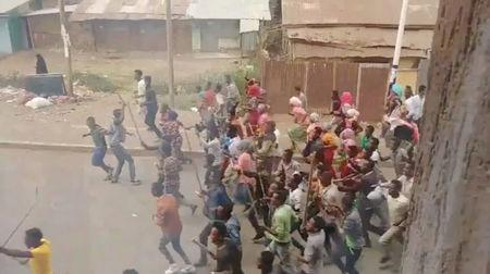Demonstrators walk along a street in Asella, Oromiya Province, Ethiopia February 13, 2018, in this still image taken from a social media video. Mandatory Credit. TWITTER/@WAGUWAGU91 via REUTERS