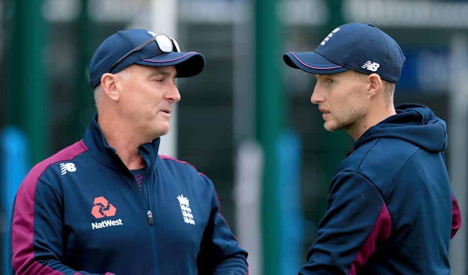 joe Root in conversation with coach Graham Thorpe (PA)