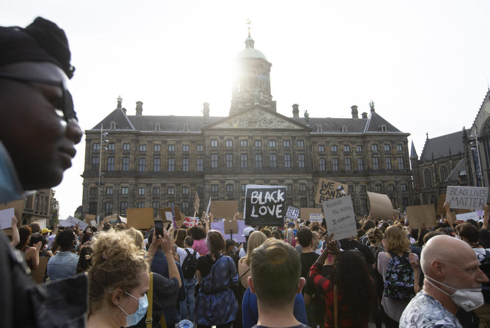 People take part in a Black Lives Matter protest in front of the Royal Palace on Dam Square in Amsterdam, Netherlands, Monday, June 1, 2020, to protest against the recent killing of George Floyd, a black man who died in police custody in Minneapolis, U.S.A., after being restrained by police officers on Memorial Day. (AP Photo/Peter Dejong)