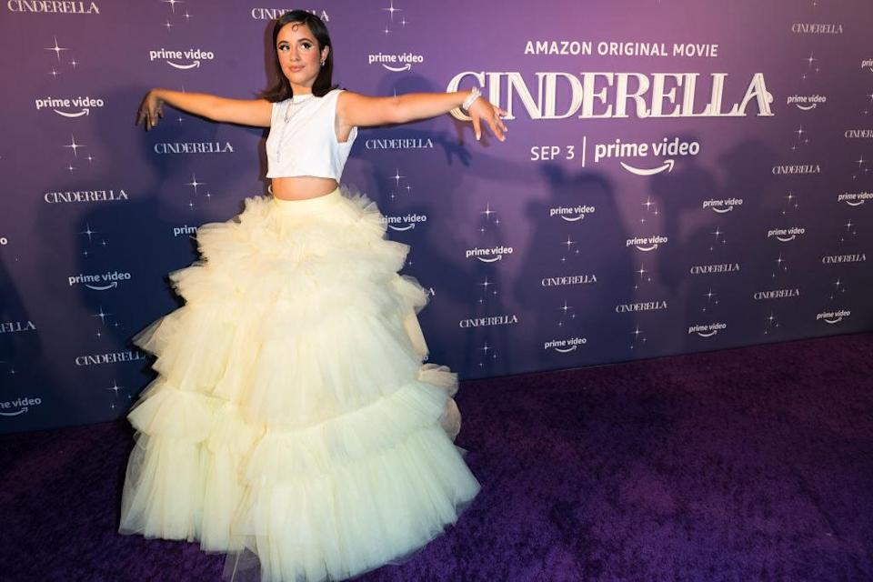 Camila in the tulle floor-length skirt standing with her hands out to the sides