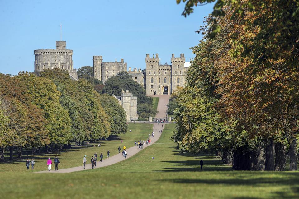 People enjoy the hot weather on the Long Walk at Windsor Castle, Berkshire. (Photo by Steve Parsons/PA Images via Getty Images)