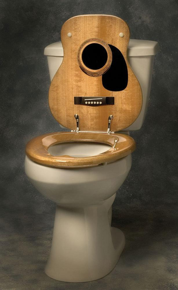 """<p>If you've ever been told that your music belongs in the toilet, why not shove that back in your friends' and family's faces with a beautiful lid that replaces porcelain with the natural wood of a classic six-string? Non-acoustic models are also available, if you really want to put your guests in the electric chair. Get it <a href=""""http://www.musictreasures.com/music/viewitem.asp?idproduct=30399"""" rel=""""nofollow noopener"""" target=""""_blank"""" data-ylk=""""slk:HERE"""" class=""""link rapid-noclick-resp"""">HERE</a>.</p>"""