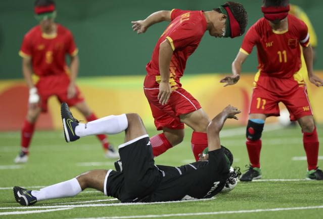 2016 Rio Paralympics - Football Soccer - Men's 5-a-side Preliminaries Pool B - China v Mexico - Olympic Tennis Centre - Rio de Janeiro, Brazil - 11/09/2016. Wang Zhoubin (CHN) of China in action with Pablo Millan (MEX) of Mexico. REUTERS/Ueslei Marcelino FOR EDITORIAL USE ONLY, NOT FOR SALE FOR MARKETING OR ADVERTISING CAMPAIGNS.