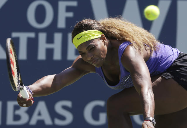 Serena Williams, of the United State, returns the ball to Andrea Petkovic, from Germany, during the first set of a semifinal in the Bank of the West Classic tennis tournament in Stanford, Calif., Saturday, Aug. 2, 2014. (AP Photo/Jeff Chiu)