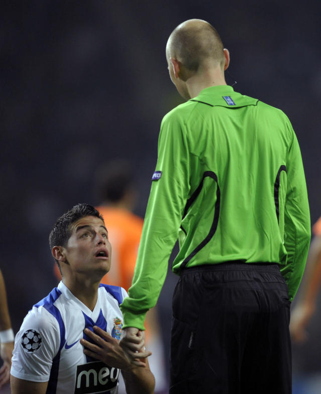 FC Porto's Colombian forward James Rodriguez (L) reacts close to French referee Antony Gautier during their UEFA Champions League Group G football match against Apoel FC at the Dragao Stadium in Porto, on October 19, 2011. The match finished with a 1-1 draw. AFP PHOTO / MIGUEL RIOPA (Photo credit should read MIGUEL RIOPA/AFP/Getty Images)