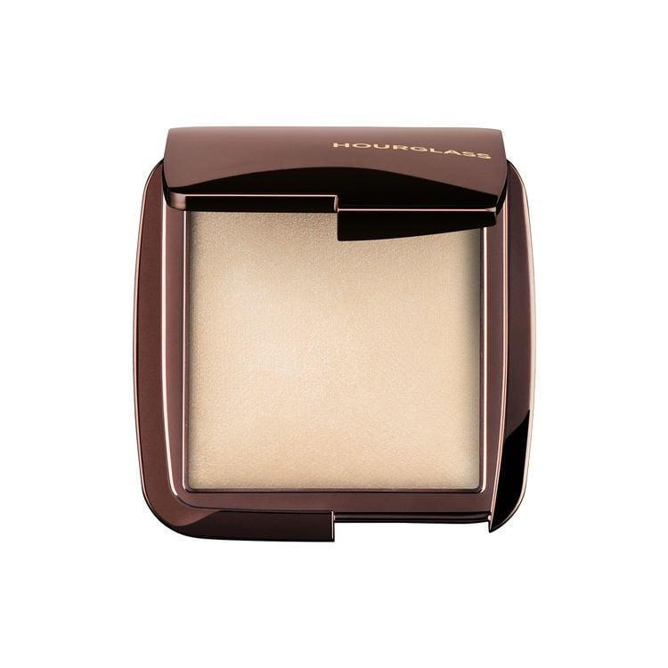 <p>While not translucent in color, the tiny color-correcting particles in these <span>Hourglass Ambient Lighting Powders</span> ($48) counteract the effects of harsh light and refine the appearance of skin.</p>