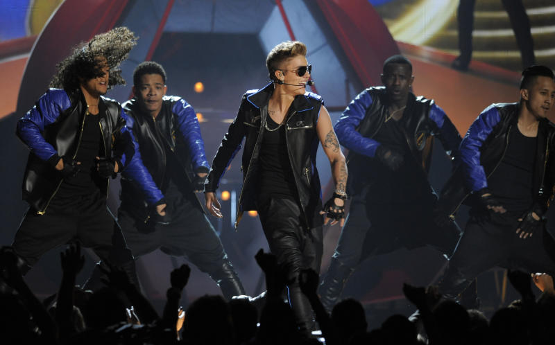 Justin Bieber, center, performs at the Billboard Music Awards at the MGM Grand Garden Arena on Sunday, May 19, 2013 in Las Vegas. (Photo by Chris Pizzello/Invision/AP)