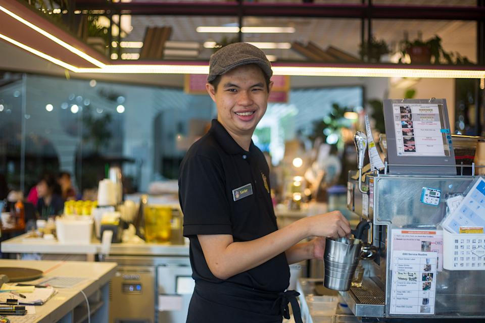 """Xavier Yap, 25, is a cafe assistant at the Pathlight School's Professor Brawn cafe, which provides job skills training for people with autism. Since working there he has invented his own coffee drink recipe and hopes to train others in service skills. Read our story: <a href=""""https://bit.ly/351P1M4"""" rel=""""nofollow noopener"""" target=""""_blank"""" data-ylk=""""slk:https://bit.ly/351P1M4"""" class=""""link rapid-noclick-resp"""">https://bit.ly/351P1M4</a> (PHOTO: Dhany Osman/Yahoo News Singapore)"""