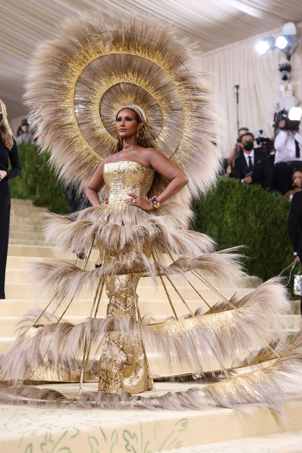 <p>Legendary supermodel Iman stole the show in a gold Harris Reed gown and headpiece. </p>