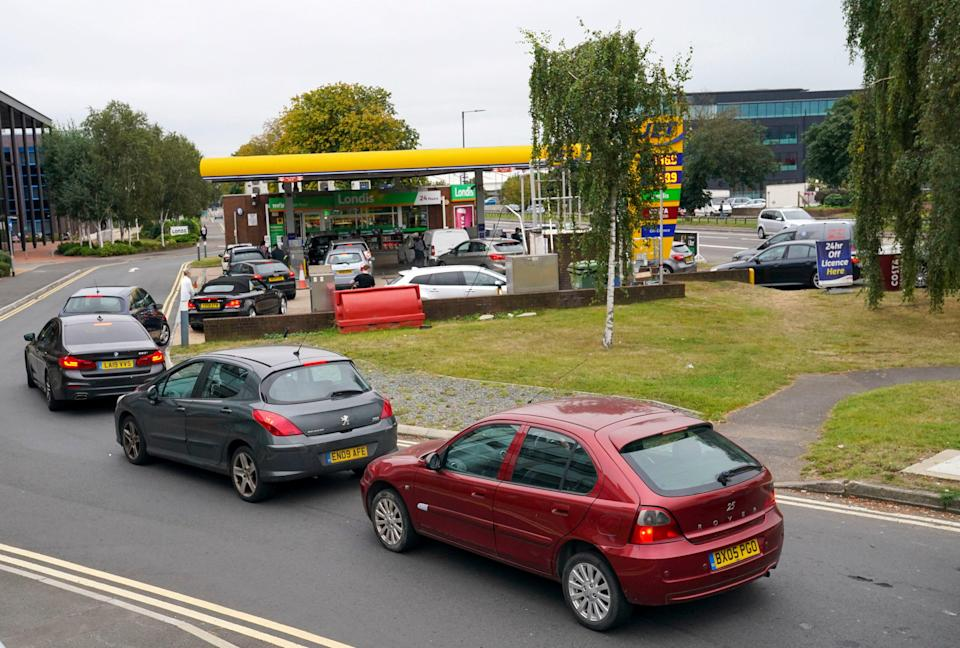 Cars queue outside petrol station in in Slough, Berkshire (PA)