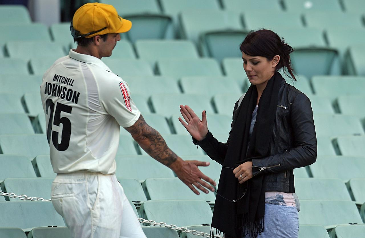 MELBOURNE, AUSTRALIA - NOVEMBER 20:  Mitchell Johnson of the Warriors is congratulated by girlfriend Jessica Bratich after day four of the Sheffield Shield match between the Victorian Bushrangers and the Western Australia Warriors at Melbourne Cricket Ground on November 20, 2010 in Melbourne, Australia.  (Photo by Scott Barbour/Getty Images)