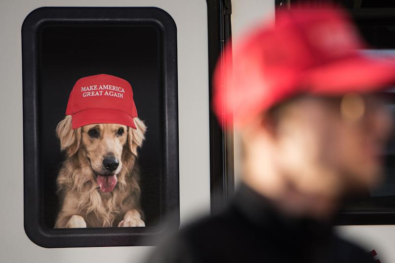 A man stands near a Donald Trump campaign vehicle with an image of a dog in a window before a campaign rally on Feb. 5, 2016, in Florence, South Carolina.