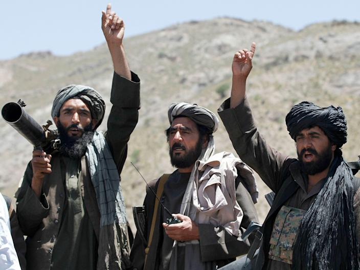 The Taliban dragged accused thieves through the streets with nooses around their necks and faces painted black