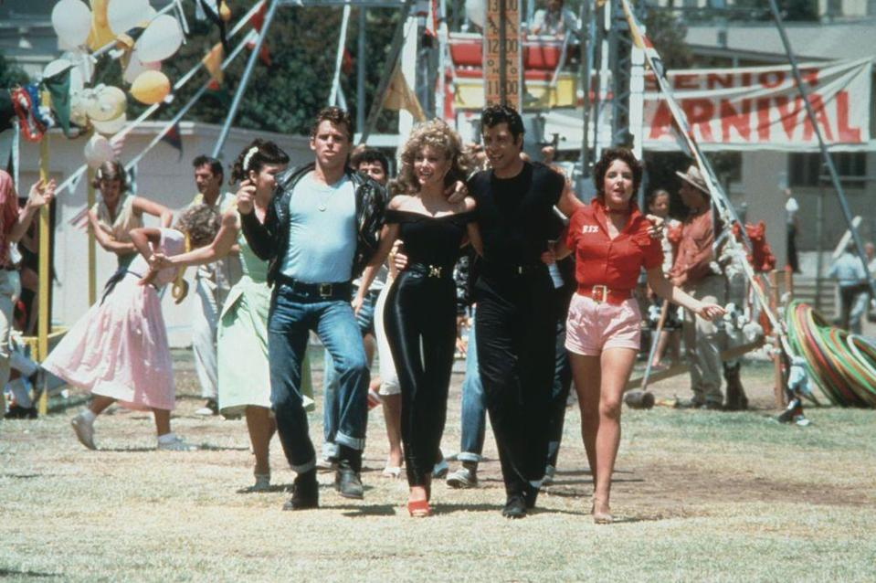 <p>There's no better scene in <em>Grease </em>than Sandy's makeover at the end. Her all-black outfit wouldn't be complete without her red statement mules. </p>