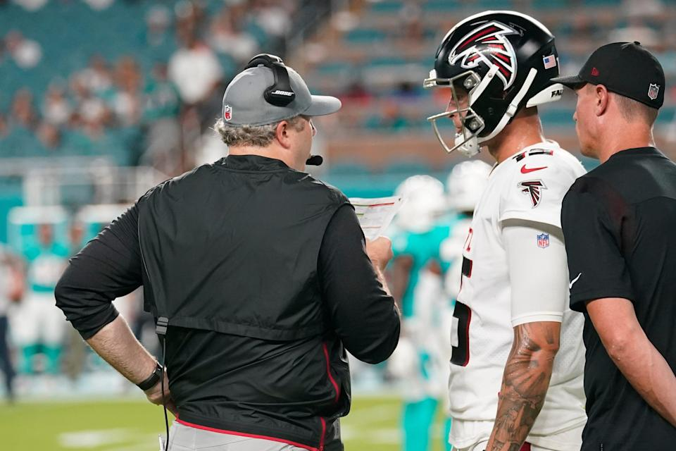 Arthur Smith talks to Falcons quarterback Feleipe Franks, during the first half of a NFL preseason football game against the Miami Dolphins. Franks and Josh Rosen will compete for the backup quarterback position.