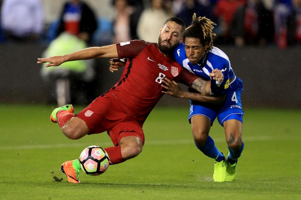 Clint Dempsey (L) of the US scores a goal as Henry Figueroa of Honduras defends during their Russia 2018 World Cup qualifier, at Avaya Stadium in San Jose, California, on March 24, 2017 (AFP Photo/Sean M. Haffey)